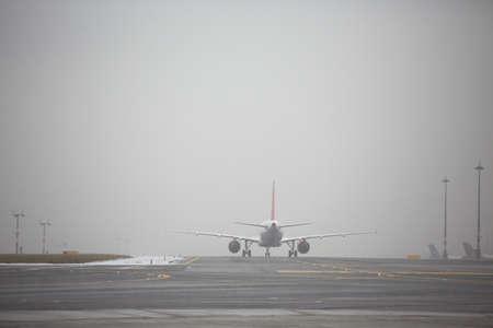 airport runway: Airport runway in bad weather