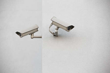 Two security cameras on a wall. Stock Photo - 17444459