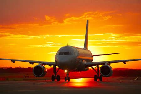 plane landing: Airplane at sunset