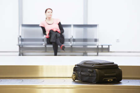 conveyor belts: Woman is waiting at the airport  Stock Photo