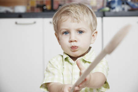12 15 months: Simple portrait of toddler in the kitchen