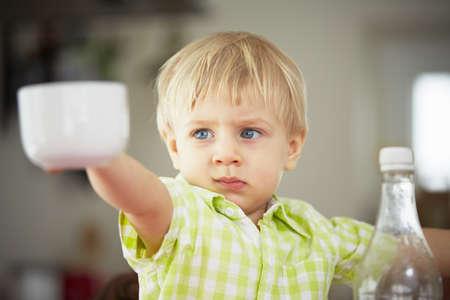 12 18 months: Little boy in the kitchen