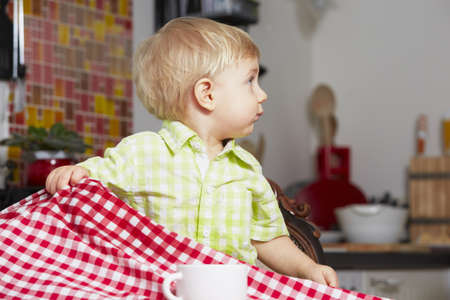 messy kitchen: Little boy in the kitchen