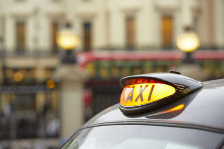 taxi sign: Taxi car in London - selective focus  Stock Photo