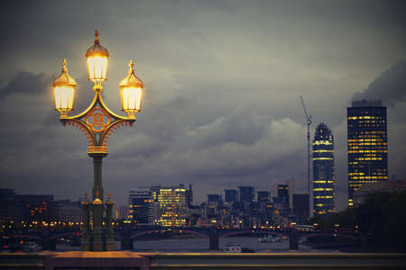 Lamp on the Westminster bridge, London, UK  photo