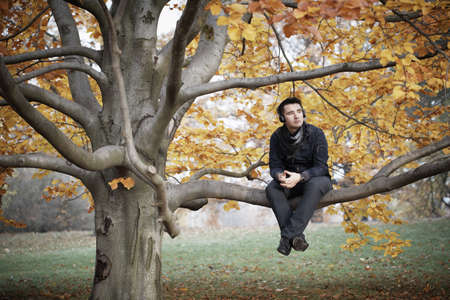 Young man in autumn park  photo