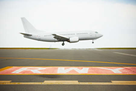 airplane landing: Aircraft is landing - selective focus on runway
