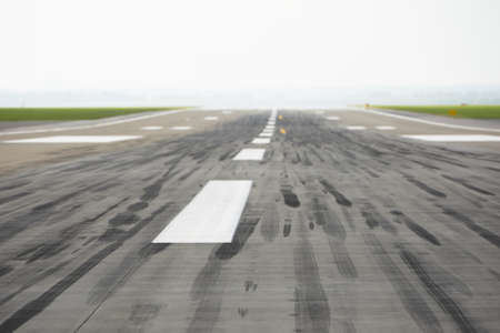 Skid marks on at the airport runway - selective focus  photo