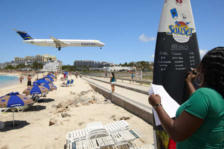 incredible: Maho beach near Princess Juliana International Airport. The airplane arrives over the full beach on April 4, 2010 in Saint Martin.  Editorial
