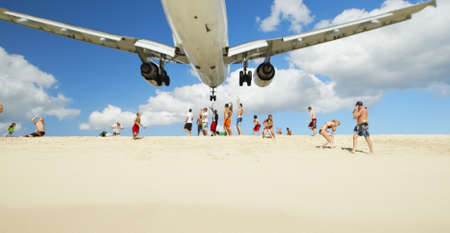 sint: Maho beach near Princess Juliana International Airport. The airplane arrives over the full beach on April 4, 2010 in Saint Martin.  Editorial