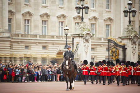 buckingham: Policewoman on the horse behind marching the Queen