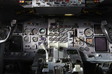 cockpit: Center console and throttles in the airplane