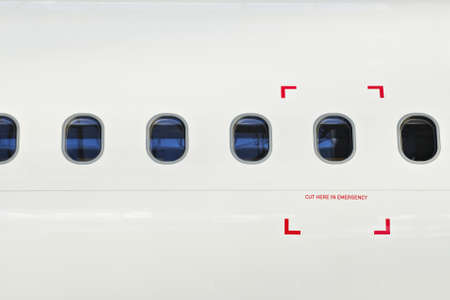 Windows of airplane with emergency sign