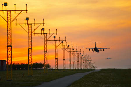 plane landing: Aircraft is landing at the sunset - selective focus