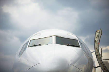 industry moody: Front view of airplane in bad weather