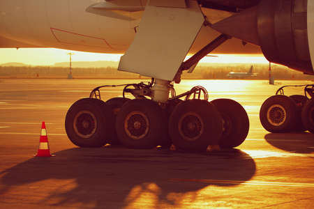 airplane take off: Undercarriage of the huge airplane at the sunset