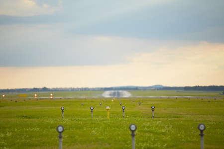 landing light: Runway - selective focus on landing light  Stock Photo
