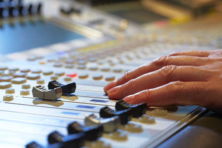 recording studio: Professional audio mixing console with faders and adjusting knobs - radio  TV broadcasting