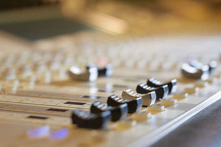 Professional audio mixing console with faders and adjusting knobs - radio  TV broadcasting photo