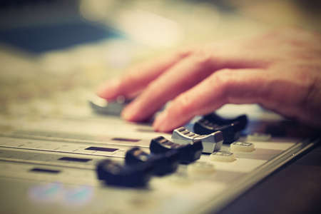 audio mixer: Professional audio mixing console with faders and adjusting knobs - radio  TV broadcasting
