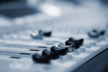 radio station: Professional audio mixing console with faders and adjusting knobs - radio  TV broadcasting