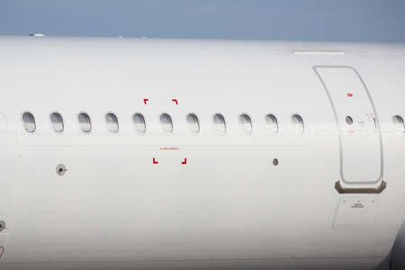 Windows of the white airplane with emergency sign.  photo