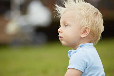 Little boy in the garden in front of house - selective focus
