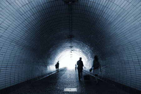 People in bricked tunnel - Prague photo
