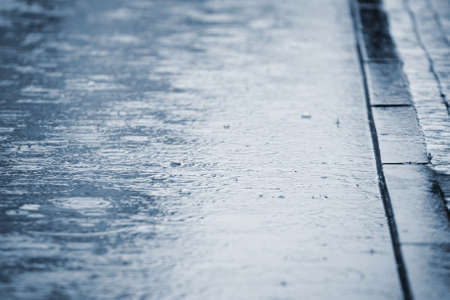 road surface: Puddle of water in rain - selective focus