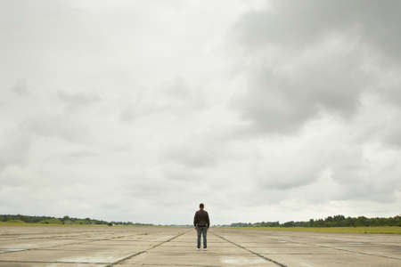 Mystery man in the midle of the old runway. Stock Photo - 19433214