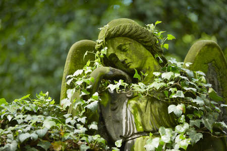 horrific: Sad angel statue on old cemetery  Stock Photo