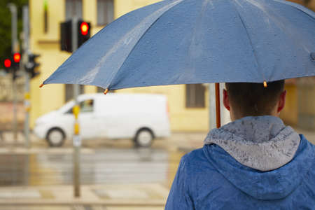 Rainy day - young man with umbrella Stock Photo - 19808837