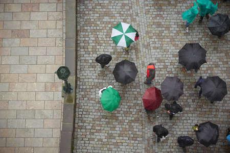 Group of people in rain - Prague, Czech Republic photo