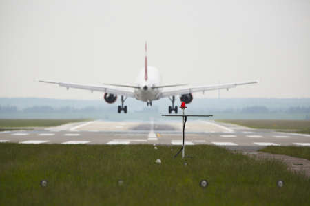 airplane landing: Airplane is landing on the airport - selective focus Stock Photo