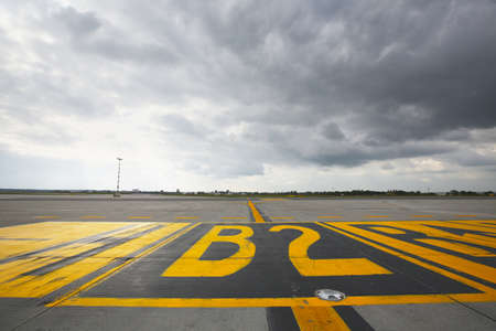 airfield: Airfield - marking on taxiway is heading to runway  Stock Photo