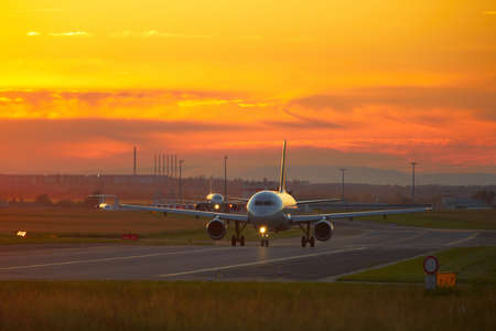 airport runway: Airport at the sunset - back lit Stock Photo