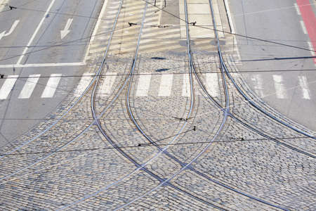 Empty city intersection in Prague - railroad of tram and road  photo