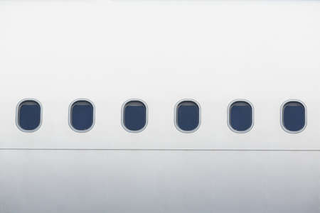 Windows of the white airplane - copy space