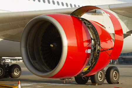 Maintenance of the jet engine before take off  Stock Photo