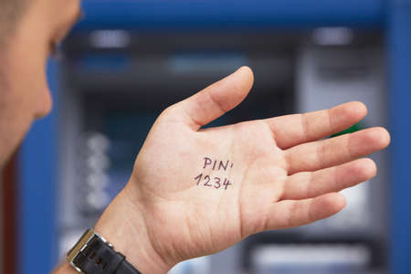 Man look at the simple PIN code written on the palm  Stock Photo - 20413426