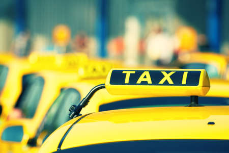 Taxi cars are waiting in row on the street - selective focus Banco de Imagens