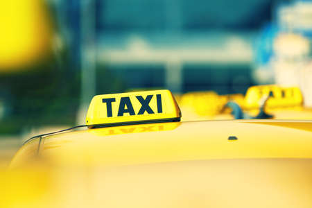 a yellow taxi: Taxi cars are waiting in row on the street - selective focus Stock Photo