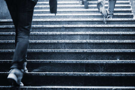 People on the staircase in rain - blurred motion Stock Photo - 20465346