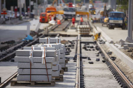 Repairing road and tram track - selective focus photo