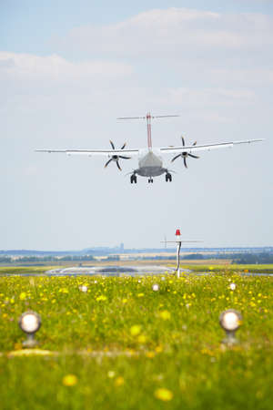 landing light: Airplane is landing at the airport