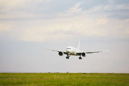 arrive: Airplane is landing at the airport - copy space