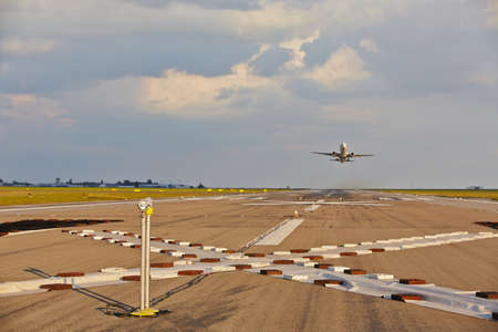 industry moody: Airplane is taking off from the airport