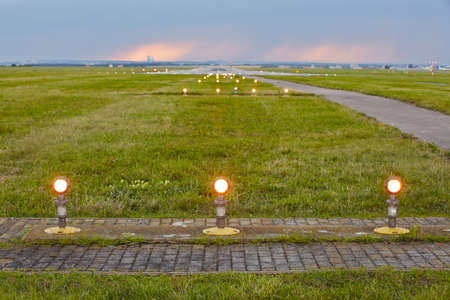 industry moody: Landing light - The storm is approaching the airport.