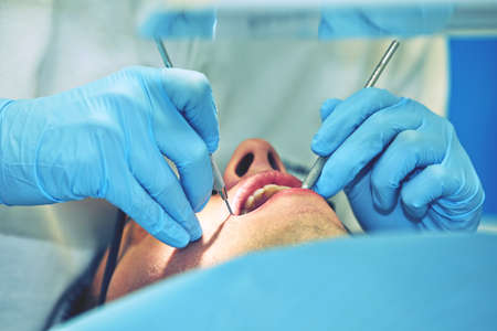 dental examination: Young man in dentist office