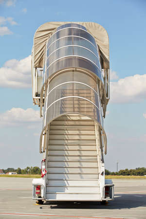 gangway: Mobile gangway for airplanes - sunny day at the airport
